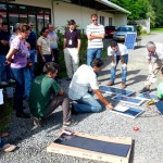 Participants reviewing the characteristics of different solar panels.
