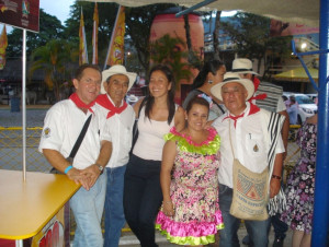 Mayra Ruiz (third from left) poses next to a group of Colombian coffee farmers.