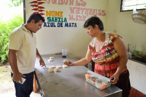 Luis Carazo, in charge of Sustainable Agricultural Development for the PDC, discusses with Ana the different kinds of soaps that she produces and sells at her farm.