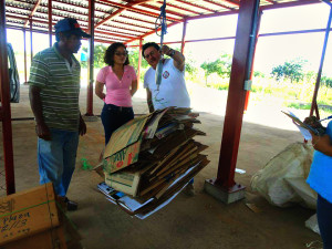 Jeanneth Valdivia stands in a recently constructed waste management plant in Honduras.