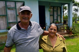 Miguel and his wife María Eugenia pose in front of their house, located in the Las Lomas community of Costa Rica.
