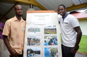 In the photo, Isaiah (right) presenting his graduation project