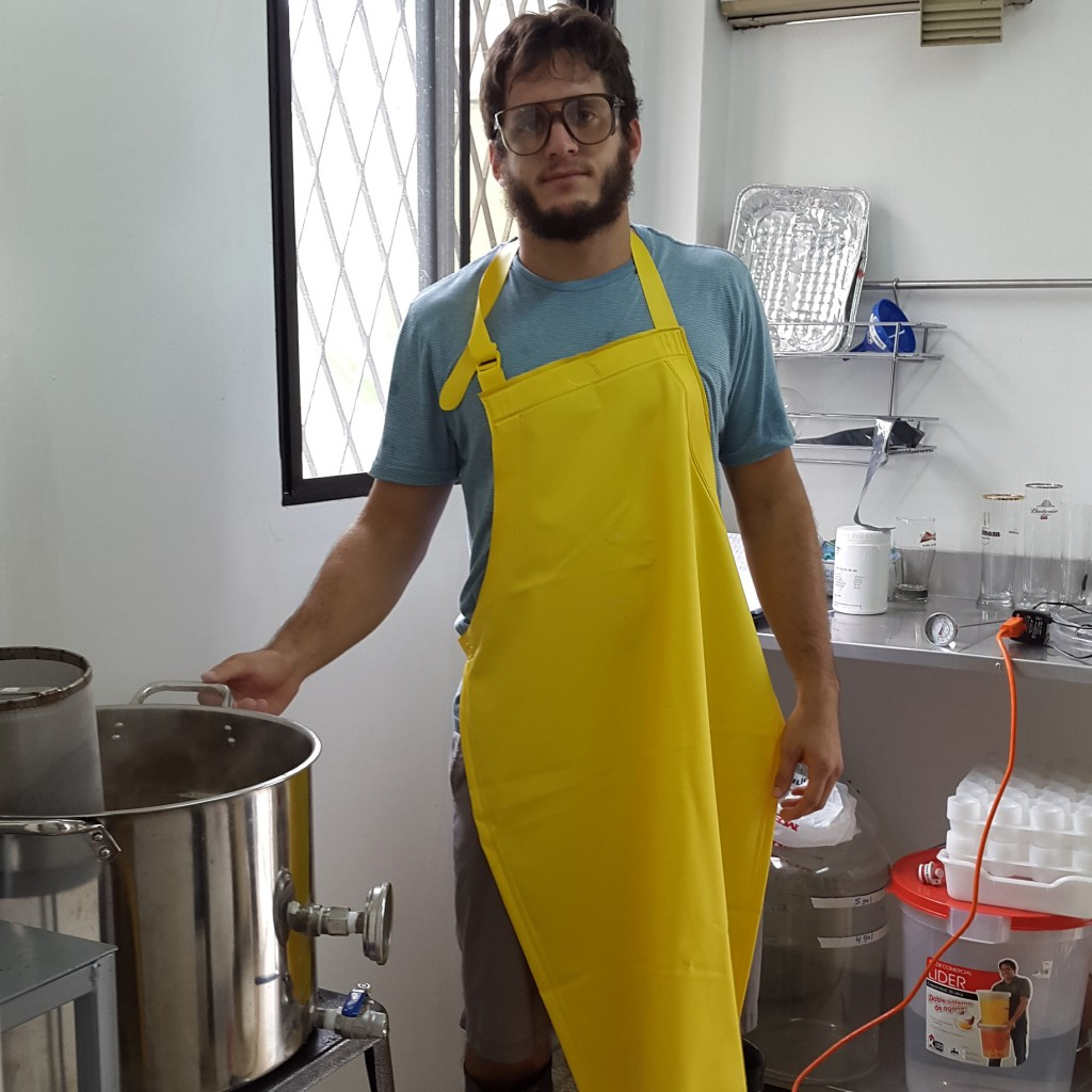 Mario in his home after graduation, completing some of the first tests on his beer. Photo courtesy of Mario Miraglia.