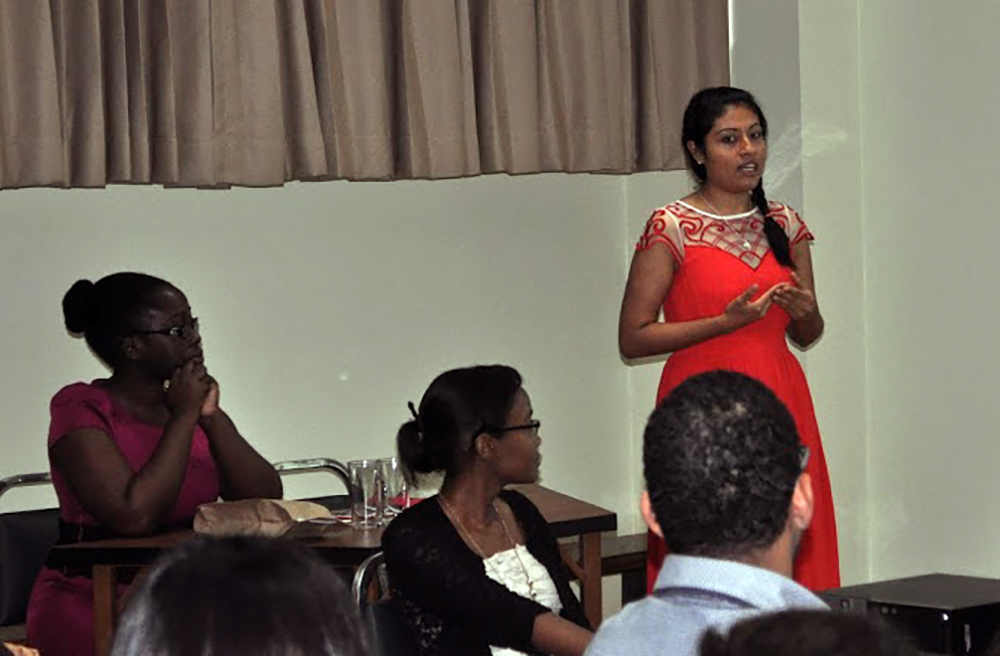 Sindy ('16, Guatemala) at a presentation during graduation week.