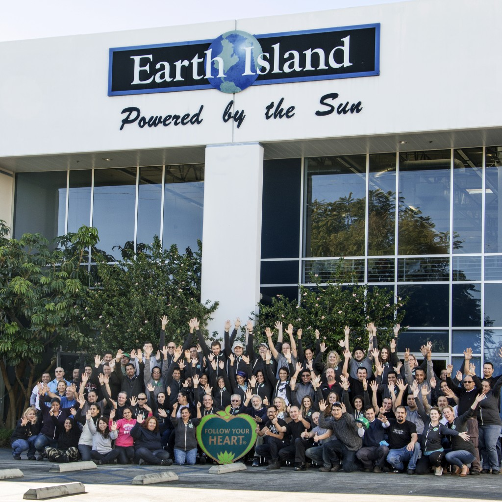 The entire Follow Your Heart team shows of its solar-powered manufacturing facility, called Earth Island.