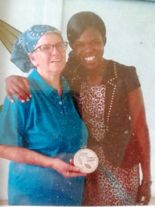 Doña Chepita with graduate Forget Shareka ('19, Zimbabwe).
