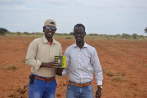 Khaalid and Saeed in the piece of land where they're working on.